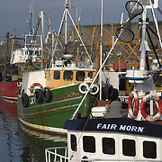 Fishing boats in the small working harbour of Port Seton, East Lothian, Scotland<br />