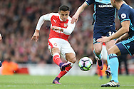 Alexis Sanchez of Arsenal taking a shot at goal. Premier league match, Arsenal v Middlesbrough at the Emirates Stadium in London on Saturday 22nd October 2016.<br /> pic by John Patrick Fletcher, Andrew Orchard sports photography.