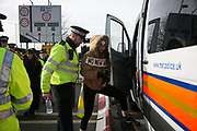 Climate activists block a road by Heathrow in protest against the proposed third runway November 19th 2016 in Heathrow, London,United Kingdom. Police were out in force and after 30 minutes the the roads were clear. 9 Arrests were made at this point of the protests which was part of larger act of civil disobedience.