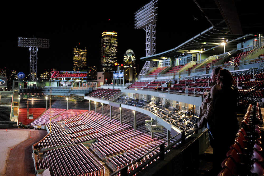 Two attendees take in Fenway empty at night during an event there in the State Street Pavillion.