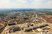 Nederland, Noord-Brabant, Eindhoven, 27-05-2013; Strijp-S, voormalige Philipsterrein, was niet toegankelijk voor het publiek, 'de verboden stad'. Het gebied, met diverse Rijksmonumenten, wordt ontwikkeld voor wonen, werken en cultuur.<br /> <br /> Onder in beeld het dak van Philitefabriek met Klokgebouw (Strijp S), in het midden het Veemgebouw met daar direct naast De Hoge (Witte) Rug. <br /> Strijp-S, former Philips area, was not accessible to the public, 'the forbidden city'. The area, with several national monuments, is designated for living, working and culture.<br /> Top image Philitefabriek / Clock Building (Strijp S), in the middle of the Veemgebouw next to the High (White) Back. <br /> <br /> luchtfoto (toeslag op standard tarieven);<br /> aerial photo (additional fee required);<br /> copyright foto/photo Siebe Swart
