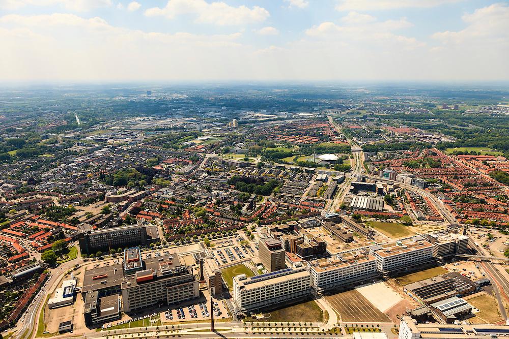 Nederland, Noord-Brabant, Eindhoven, 27-05-2013; Strijp-S, voormalige Philipsterrein, was niet toegankelijk voor het publiek, 'de verboden stad'. Het gebied, met diverse Rijksmonumenten, wordt ontwikkeld voor wonen, werken en cultuur.<br /> <br /> Onder in beeld het dak van Philitefabriek met Klokgebouw (Strijp S), in het midden het Veemgebouw met daar direct naast De Hoge (Witte) Rug. <br /> Strijp-S, former Philips area, was not accessible to the public, 'the forbidden city'. The area, with several national monuments, is designated for living, working and culture.<br /> Top image Philitefabriek / Clock Building (Strijp S), in the middle of the Veemgebouw next to the High (White) Back. <br /> <br /> luchtfoto (toeslag op standard tarieven);<br /> aerial photo (additional fee required);<br /> copyright foto/photo Siebe Swart