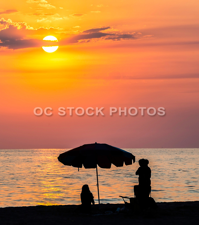 People On Tamarac Beach Watching The Sunset