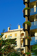 Detail of facade of two buildings, one modern, the other old. Opatija, Croatia