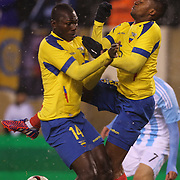 Osbaldo Lastra, (left), and Alex Ibarra, Ecuador, collide as they challenge for the same ball during the Argentina Vs Ecuador International friendly football match at MetLife Stadium, New Jersey. USA. 31st march 2015. Photo Tim Clayton