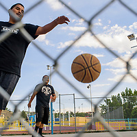 Shane Francisco, left, retrieves ball after a shot by Damian Livingston as they play a friendly game at Ford Canyon Park in Gallup Tuesday.