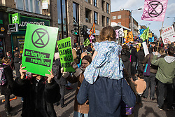 London, UK. 9th February, 2019. Activists from Extinction Rebellion block Kingsland Road in Dalston as part of a 'Saturday street party' intended as a means of engagement around climate change and environmental issues with the local community.