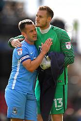 Coventry City's Michael Doyle (left) and goalkeeper Liam O'Brien celebrate at the final whistle
