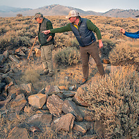 Archaeologists investigate artifacts at an early Native American settlement in the White Mountains of California.  LtoR: Robert Bettinger, Luke Barton & Micah Hale.
