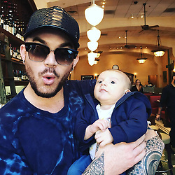 """Adam Lambert releases a photo on Instagram with the following caption: """"Kickin it w my nephew Remy! #uncleadam"""". Photo Credit: Instagram *** No USA Distribution *** For Editorial Use Only *** Not to be Published in Books or Photo Books ***  Please note: Fees charged by the agency are for the agency's services only, and do not, nor are they intended to, convey to the user any ownership of Copyright or License in the material. The agency does not claim any ownership including but not limited to Copyright or License in the attached material. By publishing this material you expressly agree to indemnify and to hold the agency and its directors, shareholders and employees harmless from any loss, claims, damages, demands, expenses (including legal fees), or any causes of action or allegation against the agency arising out of or connected in any way with publication of the material."""