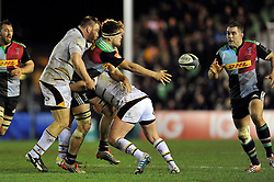 Jack Clifford of Harlequins offloads the ball after being tackled - Photo mandatory by-line: Patrick Khachfe/JMP - Mobile: 07966 386802 17/01/2015 - SPORT - RUGBY UNION - London - The Twickenham Stoop - Harlequins v Wasps - European Rugby Champions Cup