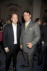 Left to right, GEORDIE GREIG editor of Tatler and JEREMY WAYNE Restaurant Editor of Tatler at the 2009 Tatler Restaurant Awards in association with Champagne Louis Roederer held at the Mandarin Oriental Hyde Park, 66 Knightsbridge, London SW1 on 19th January 2009.