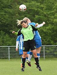FODBOLD: Maria Johansen (Taastrup FC) i duel med Stine Kristensen (OB) under kampen i 3F Ligaen mellem Taastrup FC og OB den 12. maj 2012 i Taastrup Idrætspark. Foto: Claus Birch