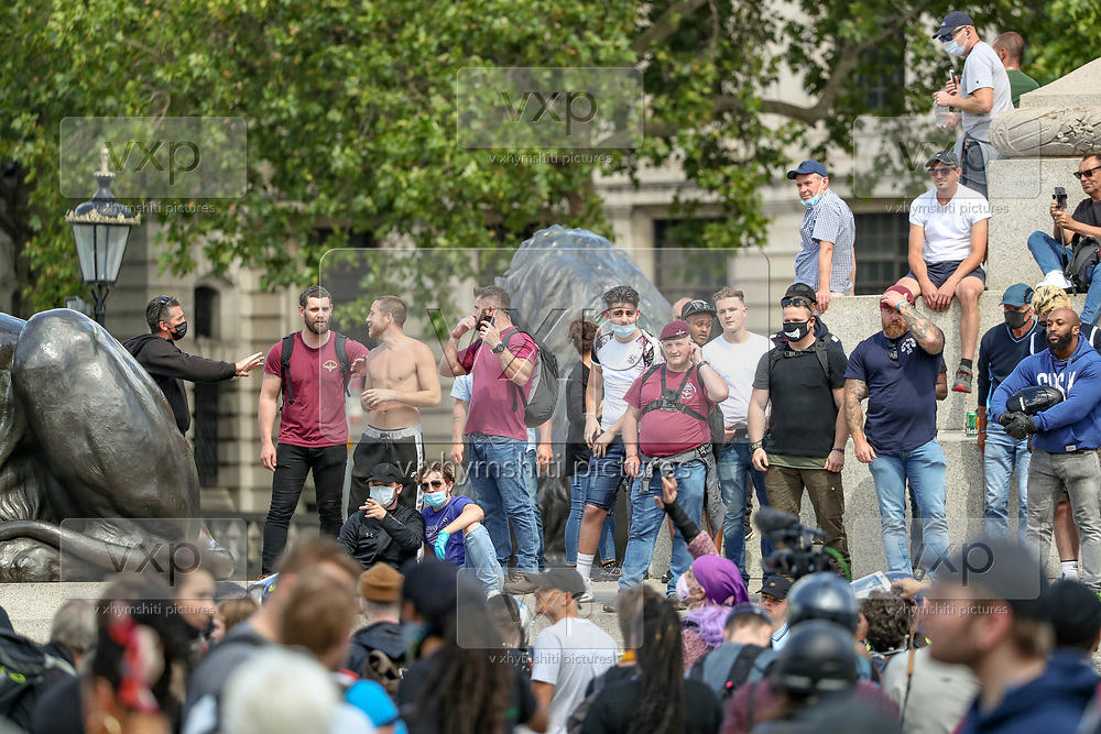 Far-right protesters gesture as they confront British police officers at Trafalgar Square in central London, during a counter-protest against a Black Lives Matter demonstration, Saturday, June 13, 2020. British police have imposed strict restrictions on groups planning to protest in London Saturday in a bid to avoid violent clashes between protesters from the Black Lives Matter movement, as well as far-right groups. (Photo/ Vudi Xhymshiti)