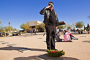 09 DECEMBER 2011 - PHOENIX, AZ:  ROBERT BELLMAN salutes after laying a Christmas wreath on a veteran's grave in Phoenix Saturday. Bellman and his wife bought 15 years wreaths this year for graves. They've been participating in the wreath laying ceremony for years. Several hundred volunteers and veterans gathered at the National Memorial Cemetery of Arizona in Phoenix Saturday to lay Christmas wreaths on headstones, a tradition started by Wreaths Across America. Wreaths Across America is a nonprofit organization founded to continue and expand the annual wreath laying ceremony at Arlington National Cemetery begun by Maine businessman, Morrill Worcester, in 1992.   PHOTO BY JACK KURTZ