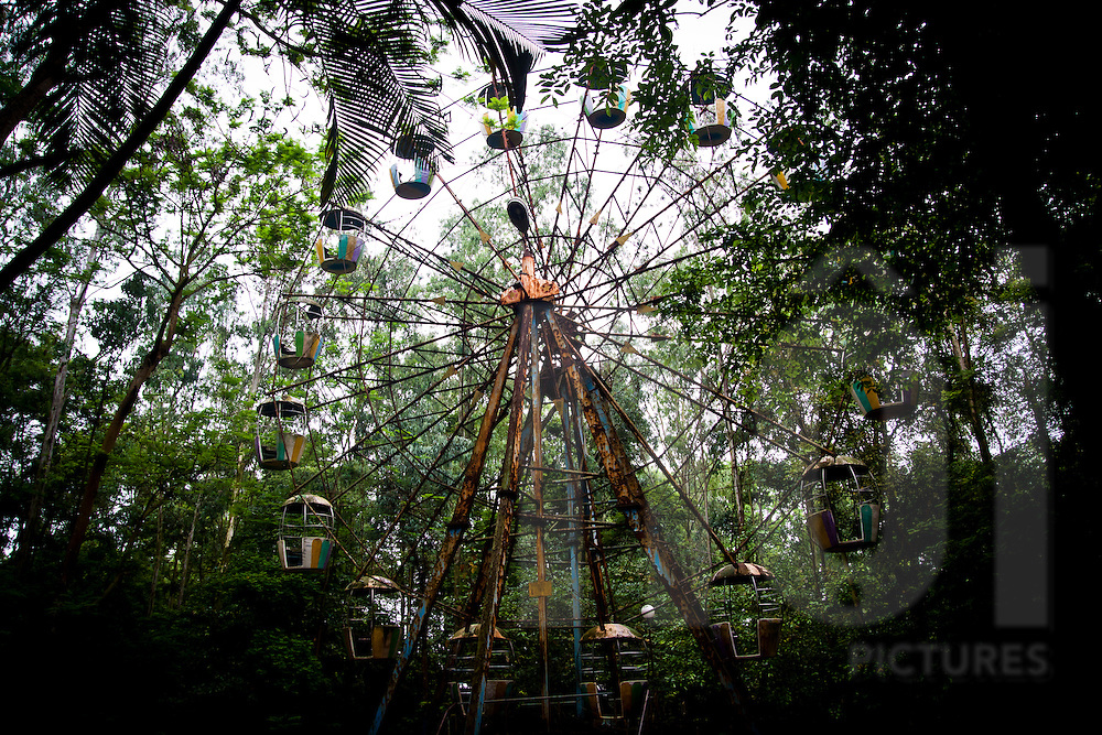 A rusted, abandoned fairground ride an old citadel in Son Tay, Vietnam