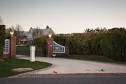 home in The Hamptons with newspapers on the driveway