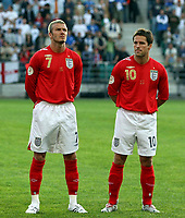 Photo: Paul Thomas.<br /> Estonia v England. UEFA European Championships Qualifying, Group E. 06/06/2007.<br /> <br /> David Beckham (L) and Michael Owen of England before kick off..