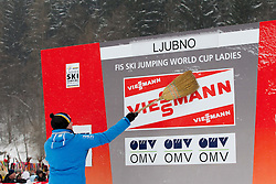 Cleaning snow before trophy ceremony after the Normal Hill Individual Competition at FIS World Cup Ski jumping Ladies Ljubno 2012, on February 12, 2012 in Ljubno ob Savinji, Slovenia. (Photo By Vid Ponikvar / Sportida.com)