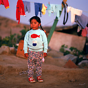 A migrant worker's daughter waits for her father to return from a nearby field in San Diego County, California. Please contact Todd Bigelow directly with your licensing requests. PLEASE CONTACT TODD BIGELOW DIRECTLY WITH YOUR LICENSING REQUEST. THANK YOU!
