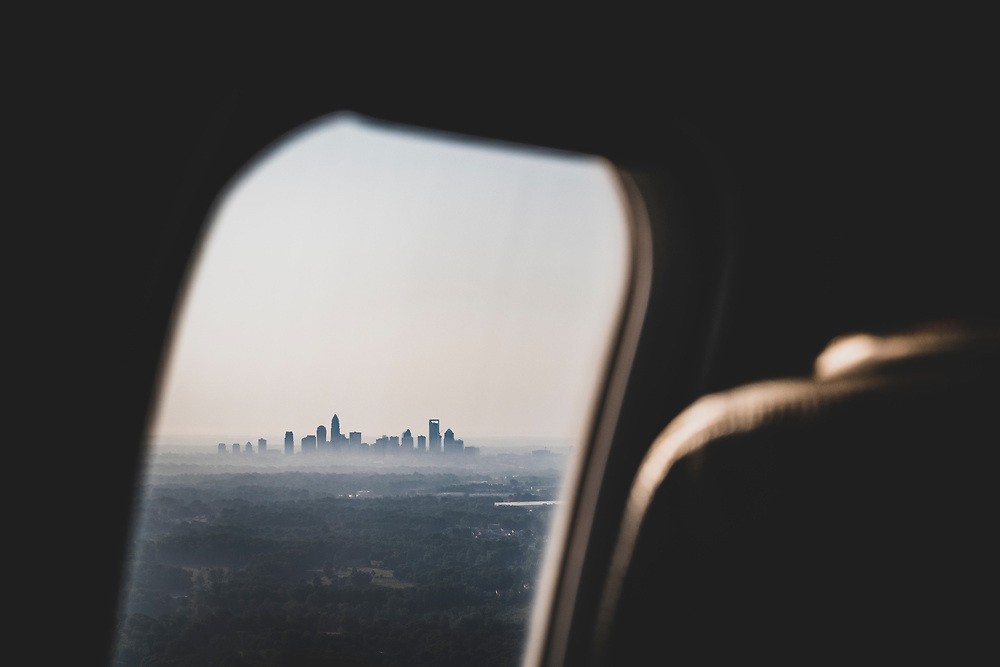 Charlotte, North Carolina - July 5, 2021: American Airlines flight 5386 from Melbourne descends into Charlotte at eight o'clock on a summer morning