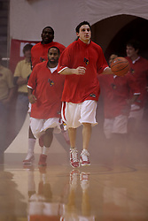 17 November 2010: Alex Rubin leads the Redbirds out of the fog and onto the floor during an NCAA basketball game between the Tennessee State Tigers and the Illinois State Redbirds at Redbird Arena in Normal Illinois.
