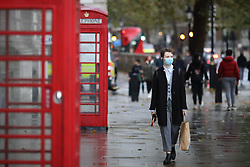 © Licensed to London News Pictures. 31/10/2020. London, UK. A person wearing a face mask in Central London. Prime Minister Boris Johnson is expected to give a press conference this afternoon amid speculation that a nationwide lockdown is imminent to slow the spread of COVID-19. Photo credit: Rob Pinney/LNP