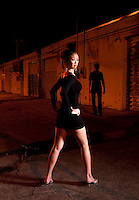 Young asiatic woman with man in abandoned alley.