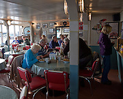 Inside traditional fish and chip cafe, Felixstowe Ferry, Suffolk, England
