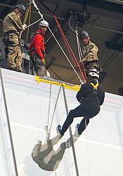 © London News Pictures. 03/09/2012. London, UK.  Prince Andrew preparing to continue his abseil following a break at a midpoint of his descent.  Prince Andrew, The Duke of York abseiling down The Shard building in Central London on September 3, 2012. The Prince joined Ffion Hague billionaire John Caudwell and a team of 37 others to take part in a charity abseil down London's tallest building to raises funds for The Outward Bound Trust and the Royal Marines Charitable Trust Fund. Photo credit: Ben Cawthra/LNP