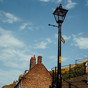 The steps from Whitby Harbour leading up to Whitby Abbey. Whitby, North Yorkshire, England. Whitby is a seaside town situated on the East coast of Yorkshire at the mouth of the River Esk, Whitby, North Yorkshire, England. 23rd July 2011. Photo Tim Clayton