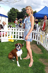 LADY ISABELLA HERVEY with her dog Humphrey at the Macmillan Cancer Relief Dog Day held at the Royal Hospital Chelsea South Grounds, London on 6th July 2004.