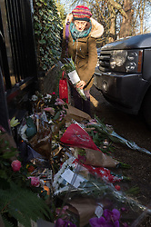 December 26, 2016 - London, London, UK - A well wisher leaves a floral tribute outside the Highgate home of singer GEORGE MICHAEL who died of heart failure at his Oxfordshire home aged 53. London, UK. (Credit Image: © Ray Tang/London News Pictures via ZUMA Wire)