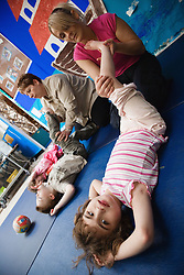 Disabled children doing therapeutic exercise,
