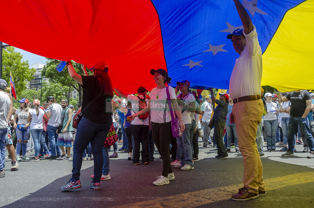 May 1, 2019 - Caracas, Miranda, Venezuela - Thousands of Venezuelans went out to march and protest against Maduro's government on Labor Day in Caracas and others cities in Venezuela (Credit Image: © Jimmy VillaltaZUMA Wire)