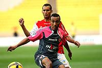 FOOTBALL - FRENCH CHAMPIONSHIP 2010/2011 - L1 - AS MONACO v RC LENS - 15/05/2011 - PHOTO PHILIPPE LAURENSON / DPPI - EDUARDO (LEN) / PEREIRA DA SILVA ADRIANO (ASM)