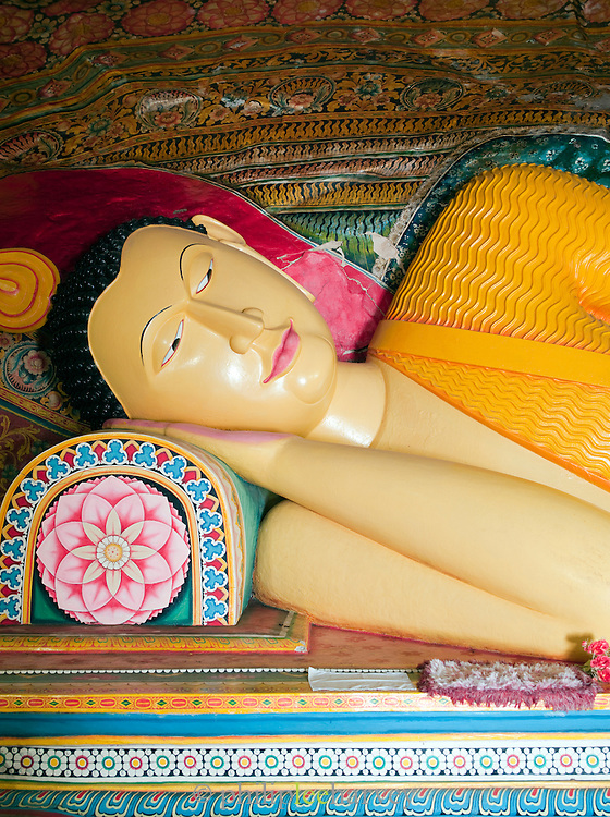 Statue of Buddha lying down in a temple of the Mulkirigala Monastery, Sri Lanka