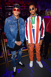 Lewis Hamilton (right) and Neymar during the Tommy Hilfiger Front row during London Fashion Week SS18 held at Roundhouse, Chalk Farm Rd, London. Picture Date: Tuesday 19 September. Photo credit should read: Ian West/PA Wire
