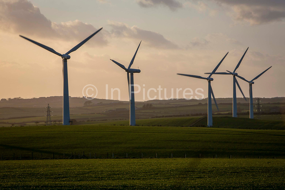 Wind turbines on Llyn Alaw Wind Farm in full electricity production during the tail end of Storm Dennis on 17th February 2020 in Anglesey, Wales, United Kingdom. Llyn Alaw Wind Farm is located on Anglesey in North Wales, it consists of 34 turbines with a capacity of 20.4 MW mega watts and can produce an average 60,000 kilowatt hours KWh each year. This is enough to provide electricity for 14,000 homes in the local community.
