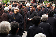 Buddhist monks and lay people chant at an early morning service at Longshan Temple in Taipei, Taiwan.