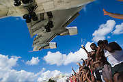 Maho Beach. Plane watchers welcome a Corsair Boeing 747 landing at Juliana Airport.