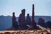 "Totem Pole and Yei-Bi-Chei rock formations in Monument Valley Navajo Tribal Park, Arizona, USA. The eastern formation resembles Navajo dancers emerging from a Hogan as part of the spiritual ""Yei-Bi-Chei"" dance performed during a sacred nine-day ceremony called the ""Night Way Ceremony."""