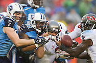 NASHVILLE, TN - NOVEMBER 27:   Josh Freeman #5 of the Tampa Bay Buccaneers is tackled by Dave Ball #98 of the Tennessee Titans and fumbles the ball at the end near the game at LP Field on November 27, 2011 in Nashville, Tennessee.  The Titans defeated the Buccaneers 23 to 17.  (Photo by Wesley Hitt/Getty Images) *** Local Caption *** Josh Freeman; Dave Ball Sports photography by Wesley Hitt photography with images from the NFL, NCAA and Arkansas Razorbacks.  Hitt photography in based in Fayetteville, Arkansas where he shoots Commercial Photography, Editorial Photography, Advertising Photography, Stock Photography and People Photography