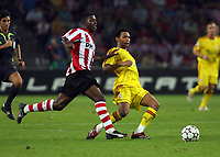Photo: Chris Ratcliffe.<br /> PSV Eindhoven v Liverpool. UEFA Champions League, Group C. 12/09/2006.<br /> Jermaine Pennant of Liverpool clashes with Edison Mendez of PSV Eindhoven.