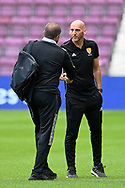 Manager of Celtic FC, Ange Postecoglou shakes hands with referee Bobby Madden before the Cinch SPFL Premiership match between Heart of Midlothian FC and Celtic FC at Tynecastle Park, Edinburgh, Scotland on 31 July 2021.