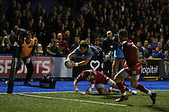 Blaine Scully of Cardiff Blues dives over the top of Steffan Evans of the Scarlets to score  a spectacular try in the 2nd half. Guinness Pro12 rugby match, Cardiff Blues v Scarlets at the BT Cardiff Arms Park in Cardiff, South Wales on Friday 28th October 2016.<br /> pic by Andrew Orchard, Andrew Orchard sports photography.