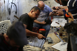 August 29, 2017 - Gaza, Palestine - A Palestinian man sharpen knives at his workshop in Gaza city on August 29, 2017. The knives use to slaughter cattle and sheep for the Muslim holiday of Eid al-Adha or the Feast of Sacrifice, which marks the end of the annual pilgrimage. (Credit Image: © Majdi Fathi/NurPhoto via ZUMA Press)