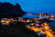 Streets and bridges illuminated at night in Reine, Moskenesoya, Lofoten Islands, Norway.