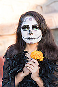 A young woman dressed as La Calavera Catrina during the final day of the Day of the Dead festival November 2, 2016 in San Miguel de Allende, Guanajuato, Mexico. The week-long celebration is a time when Mexicans welcome the dead back to earth for a visit and celebrate life.