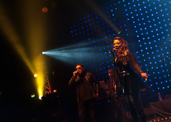 © Licensed to London News Pictures. 10/05/2012. London, UK.  Happy Mondays perform live at O2 Academy Brixton.  In picture - Shaun Ryder (vocals), Rowetta Satchell (vocals).  Photo credit : Richard Isaac/LNP